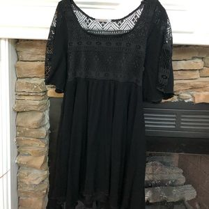 Short black dress with lace on back and shoulders